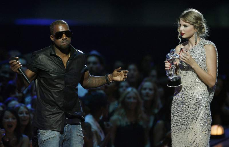 """FILE - In this Sept. 13, 2009 file photo, singer Kanye West takes the microphone from singer Taylor Swift as she accepts the """"Best Female Video"""" award during the MTV Video Music Awards  in New York.   Swift may have ended her feud with Katy Perry but the one with Kanye West seems simply not to want to die. New leaked video clip of the entire four-year-old phone call between the rapper and pop superstar about his controversial song """"Famous"""" have been posted online and further complicate the picture of what happened.(AP Photo/Jason DeCrow, File)"""