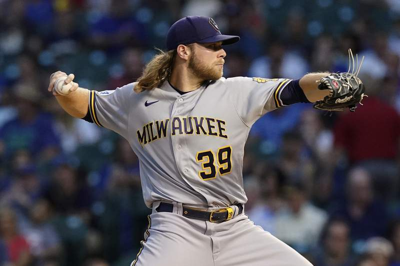 Milwaukee Brewers starting pitcher Corbin Burnes throws to a Chicago Cubs batter during the first inning of a baseball game in Chicago, Wednesday, Aug. 11, 2021. (AP Photo/Nam Y. Huh)
