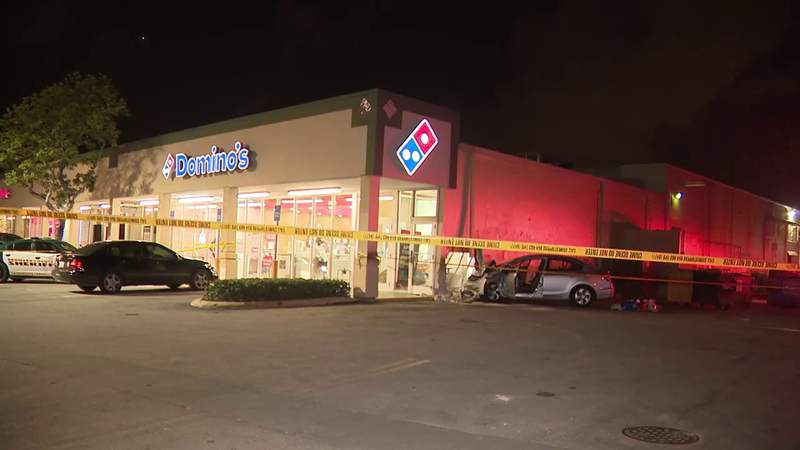 Woman dies after crashing into side of Lauderdale Lakes Domino's Pizza