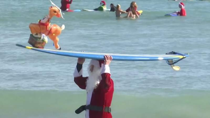 Surfing Santas scales back annual Christmas Eve event during coronavirus pandemic