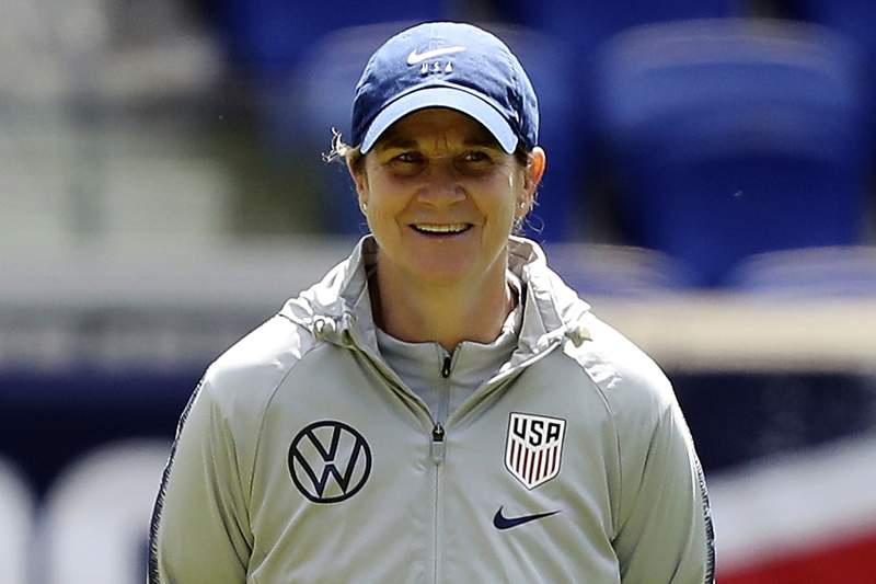 FILE - In this May 25, 2019, file photo, United States women's national soccer team head coach Jill Ellis smiles during a training session at Red Bull Arena, in Harrison, N.J. When Ellis stepped down as coach of the national team last year, U.S. soccer announced that it would endow a scholarship in Ellis' name to support female candidates in pursuit of Pro, A and B coaching license courses. On Tuesday, Oct. 6, 2020, the federation announced the SheChampions Mentorship Program, designed to support each Pro and A license candidate. Ellis is among those who will mentor the women in the program.  (AP Photo/Steve Luciano, File)