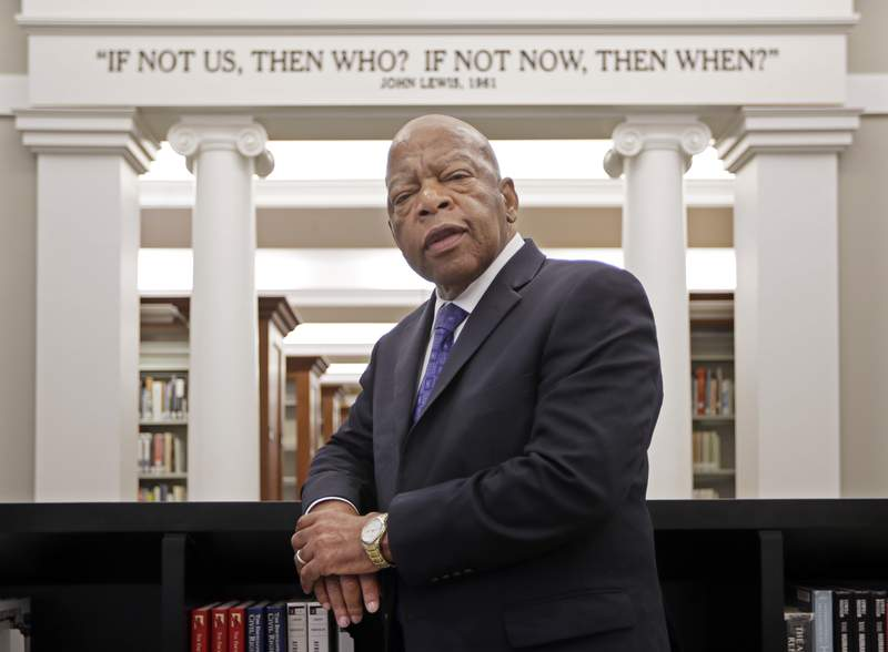 FILE - This Nov. 18, 2016 file photo shows Rep. John Lewis, D-Ga., in the Civil Rights Room in the Nashville Public Library in Nashville, Tenn.  Some last thoughts from Lewis will be published this summer. Grand Central Publishing announced Tuesday that Lewis Carry On: Reflections for a New Generation will come out July 13, almost a year after he died at age 80. (AP Photo/Mark Humphrey, File)