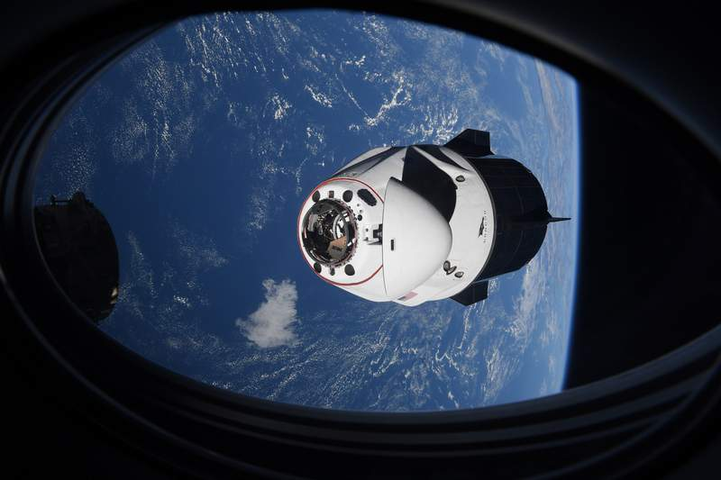 In this Saturday, April 24, 2021 photo made available by NASA, the SpaceX Crew Dragon capsule approaches the International Space Station for docking. (NASA via AP)