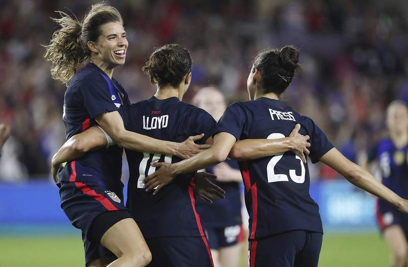 USA players celebrate after a Carli Lloyd goal during the She Believes Cup women's soccer game of USA vs. England at Exploria Stadium in Orlando on Thursday, March 5, 2020. (Stephen M. Dowell/Orlando Sentinel via AP)