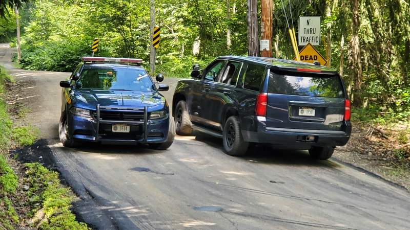 "New York State Police block off a road near the scene where the body of Roy Den Hollander was found on Monday, July 20, 2020 near Livingston Manor, N.Y. Hollander, a self-described ""anti-feminist"" lawyer found dead in the Catskills of an apparent self-inflicted gunshot wound, is being investigated as the possible gunman in the shooting of a federal judge's family in New Jersey. (Jim Sabastian/The Times Herald-Record via AP)"