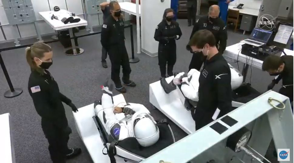NASA astronauts Bob Behnken and Dough Hurley put their space suits on with the help of SpaceX teams on May 30, 2020.