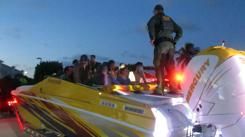 A deputy found 32 undocumented migrants hiding in a go-fast boat on a trailer attached to a truck on Monday during a traffic stop in Monroe County.