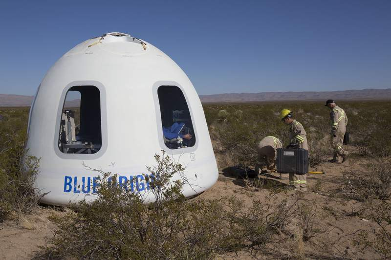 FILE - This Tuesday, Dec. 12, 2017 photo provided by Blue Origin shows the New Shepard Crew Capsule 2.0 after landing in west Texas during a test. Named after the first American in space, Alan Shepard, the spacecraft made a 10-minute suborbital flight. An instrumented test dummy was aboard, named Mannequin Skywalker. (Blue Origin via AP)