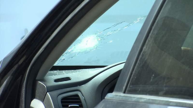 Vehicle struck by bullet.