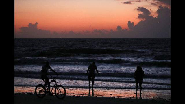 COCOA BEACH, FLORIDA - AUGUST 31: People gather to watch the sunrise as Hurricane Dorian approaches Florida on August 31, 2019 in Cocoa Beach, Florida. Dorian could be a Category 4 storm when it passes the state and possibly makes landfall as early as Monday somewhere along the east coast. (Photo by Mark Wilson/Getty Images)