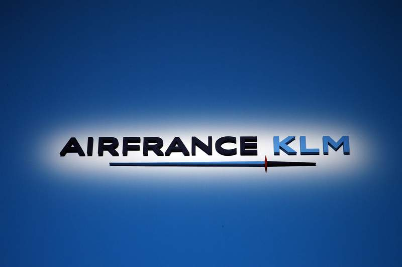 """FILE - This May 15, 2018 fie photo shows the logo of Air France-KLM is pictured during the annual shareholders meeting in Paris. French-Dutch airline group Air France-KLM said Friday July 30, 2021 that the """"first signs of recovery are visible"""" in bookings amid easing pandemic travel restrictions as it reported a second-quarter net loss of nearly 1.5 billion euros ($1.8 billion). (AP Photo/Christophe Ena, File)"""