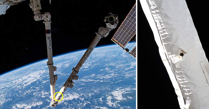 A small hole seen in the ISS Canadarm2. (Credit: NASA/Canadian Space Agency)