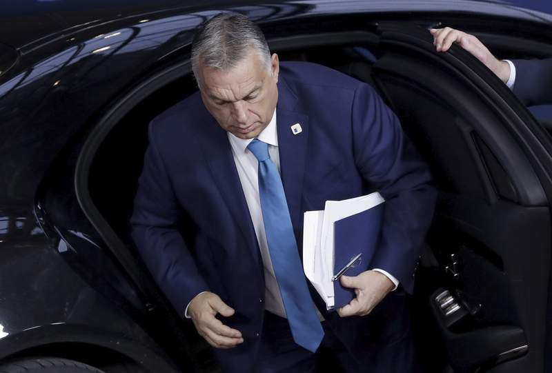 FILE - In this Friday, Oct. 16, 2020 file photo, Hungary's Prime Minister Viktor Orban arrives for an EU summit in Brussels. A senior legal adviser said Thursday, Dec. 3, 2020 that the European Union's top court should reject Hungary's attempts to overturn a European Parliament action aimed at holding the country to account for what lawmakers consider to be a breach of the bloc's values. (Olivier Hoslet, Pool via AP, File)