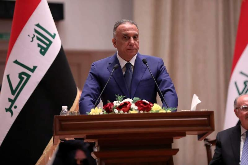 Mustafa al-Kahdimi, Iraqi Prime Minister-designate speaks to members of the Iraqi parliament in Baghdad, Iraq, Thursday, May 7, 2020. Iraq's former spy chief was sworn in early Thursday as the prime minister by lawmakers after weeks of tense political negotiations as the country faces a severe economic crisis spurred by the coronavirus pandemic. The parliament approved the government of al-Kahdimi after long wrangling over his proposed Cabinet. (Iraqi Parliament Media Office, via AP)