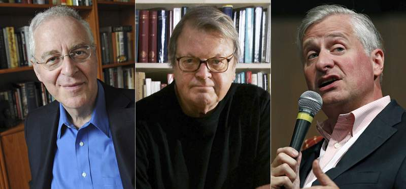 This combination photo shows Pulitzer-Prize winning authors, from left, Ron Chernow, Garry Wills and Jon Meacham, who are among hundreds of historians who have signed an open letter calling for President Donald Trump to be removed from office. The letter comes after last weeks siege of the U.S. Capitol by his supporters. (AP Photo)