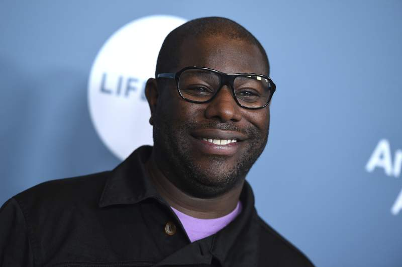 FILE - Steve McQueen arrives at The Hollywood Reporter's Women in Entertainment Breakfast in Los Angeles on Dec. 5, 2018. In a movie year mostly lacking big, ambitious releases, McQueens Small Axe anthology is an unqualified main event. While many other filmmakers are on hold, the 12 Years a Slave director has raced to finish not one but five new films. The movies, spanning 1968 to 1985, are each individual stories of the West Indian community in London. (Photo by Jordan Strauss/Invision/AP, File)