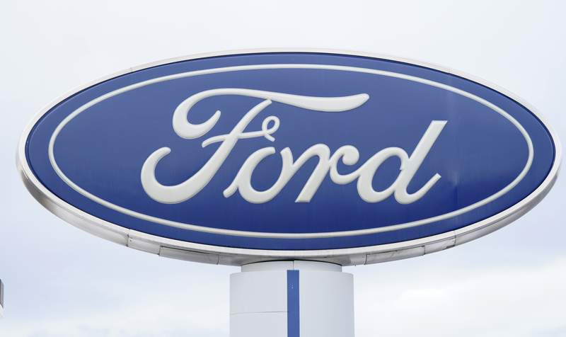 FILE - In this Sunday, Dec. 20, 2020, file photo, the company logo is viewed on a sign outside a Ford dealership, in Centennial, Colo. Ford has lost track of some older Takata air bags that can explode and hurl shrapnel, so it's recalling more than 154,000 vehicles in North America to check for them. The company on Thursday, Feb. 18, 2021, issued two recalls, with the largest coming because Ford can't find 45 obsolete air bags that may have been installed on some old Ranger pickup trucks. (AP Photo/David Zalubowski, File)