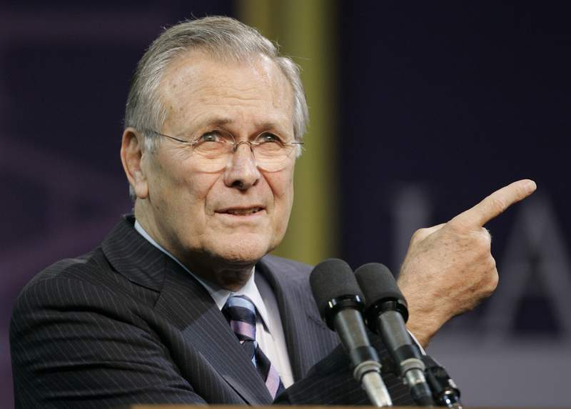 FILE - In this Nov. 9, 2006, file photo, Defense Secretary Donald Rumsfeld asks for another question following his Landon Lecture at Kansas State University in Manhattan, Kan.  News of the death of former U.S. Defense Secretary Donald Rumsfeld has hit far differently in Baghdad than in the U.S. capital. Rumsfeld, whose service under four U.S. presidents was stained by the ruinous U.S.-led invasion of Iraq, died on Wednesday, June 30, 2021. (AP Photo/Orlin Wagner)