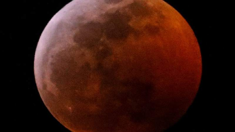 A 'Super Blood Moon' is seen in Los Angeles, Sunday Jan. 20, 2019. (AP Photo/Ringo H.W. Chiu)
