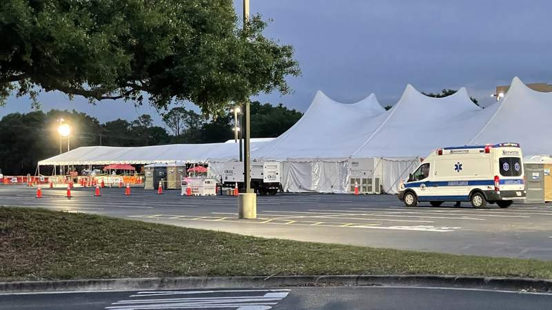 Rain temporarily closed the FEMA-backed vaccine site at Valencia College West Campus in Orlando Tuesday