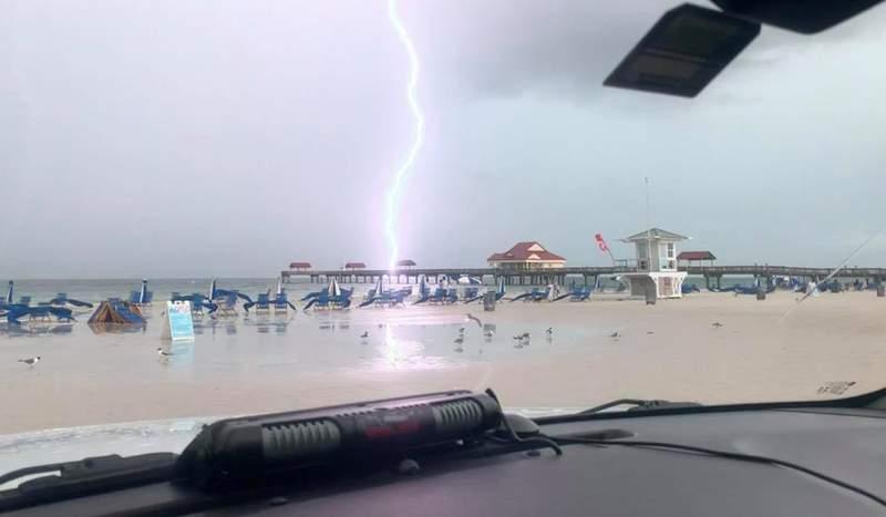 Lightning strikes near a beach in Clearwater on July 14, 2021.