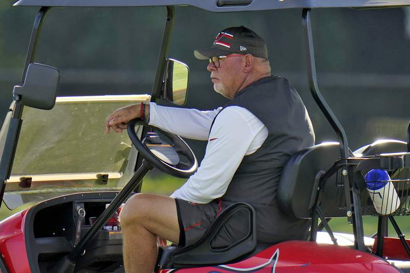 Tampa Bay Buccaneers head coach Bruce Arians watches from his cart during an NFL football minicamp Tuesday, June 8, 2021, in Tampa, Fla. (AP Photo/Chris O'Meara)