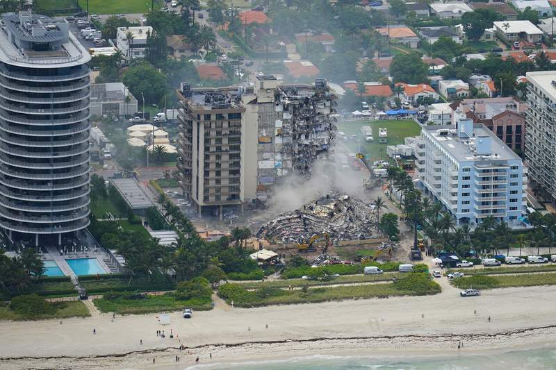 Rescue personnel work in the rubble at the Champlain Towers South Condo, Friday, June 25, 2021, in Surfside. The seaside condominium building partially collapsed on Thursday. (AP Photo/Gerald Herbert)