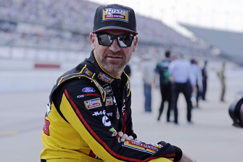 FILE - In this Aug. 31, 2019, file photo, Clint Bowyer waits on pit road for his turn to qualify for the NASCAR Cup Series auto race at Darlington Raceway in Darlington, S.C. wyer, popular among his peers and a beloved by fans, would have preferred a proper send-off in his final year as a NASCAR driver. Instead, hell settle for a farewell party Sunday at Kansas Speedway. Bowyer is retiring from racing at the end of this season and move into the Fox Sports booth. (AP Photo/Terry Renna, File)