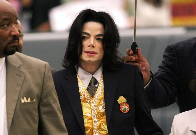 FILE - In this May 25, 2005, file photo, Michael Jackson arrives at the Santa Barbara County Courthouse for his trial in Santa Maria, Calif. On Monday, May 3, 2021, a U.S. tax court handed a major victory to Jackson's estate in a years-long battle, finding that the IRS inflated the value of Jacksons assets and image at the time of his 2009 death. (Aaron Lambert/Santa Maria Times via AP, Pool, File)