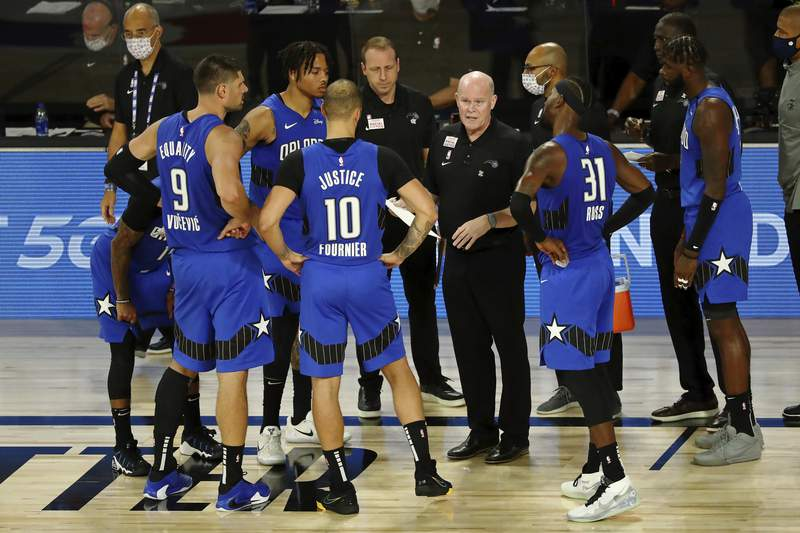 Orlando Magic head coach Steve Clifford talks with the team during a time out in the second half of Game 1 of an NBA basketball first-round playoff series against the Milwaukee Bucks, Tuesday, Aug. 18, 2020, in Lake Buena Vista, Fla. (Kim Klement/Pool Photo via AP)