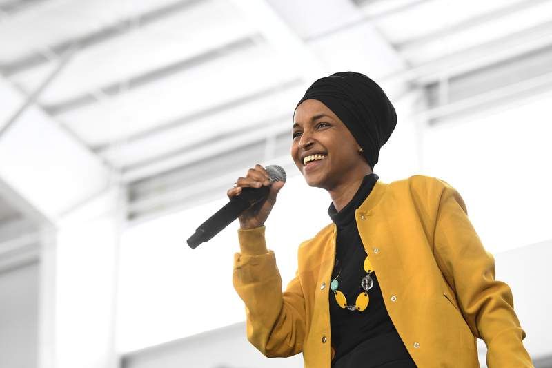 FILE - In this Feb. 29, 2020 file photo, Rep. Ilhan Omar, D-Minn., speaks at a rally in Springfield, Mass. Rep. Omar has announced her remarriage, just four months after her marriage ended following an allegation she was having an affair with her political consultant. Omar posted the news on her Instagram account Wednesday, March 11, 2020, with a photo that showed her and a bearded man smiling and displaying wedding rings. (AP Photo/Susan Walsh File)