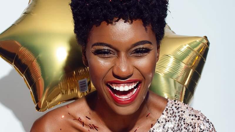 A woman smiles.