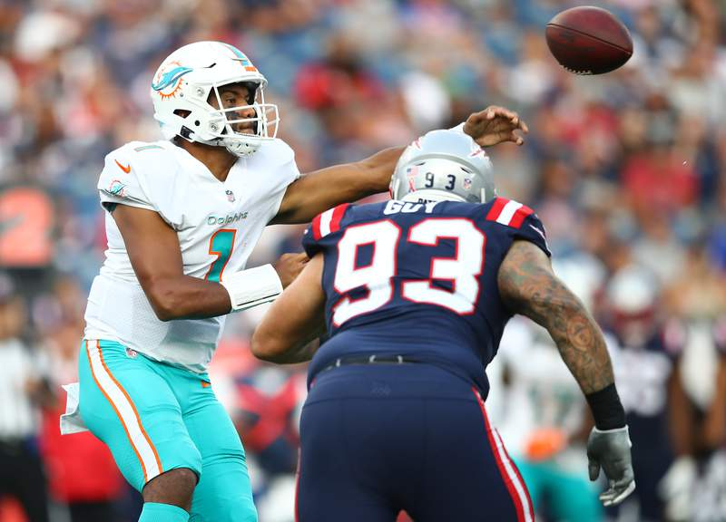 Dolphins QB Tua Tagovailoa throws a pass during the first half against the New England Patriots in the season opener.