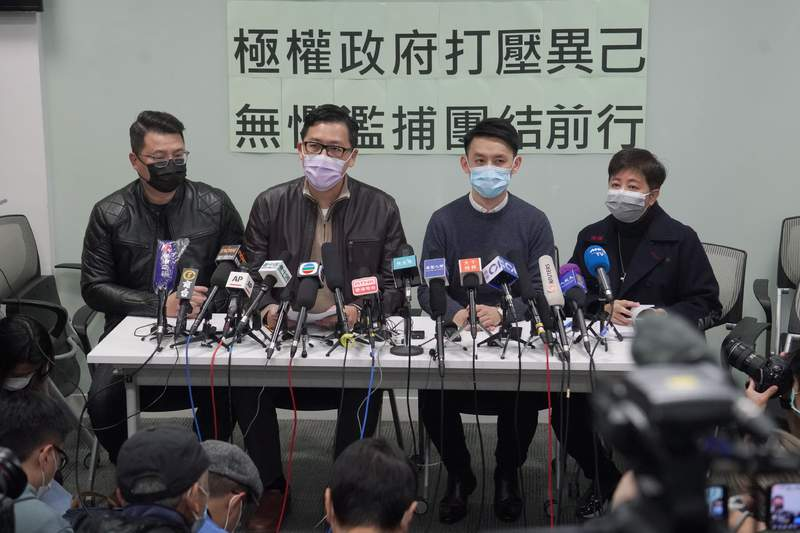 "Former Democratic Party legislators Andrew Wan, left, Lam Cheuk-ting, second left, and Helena Wong, right, attend a press conference after being released on bail in Hong Kong, Friday, Jan. 8, 2021. Some former Hong Kong legislators and pro-democracy activists were released on bail late Thursday, after being arrested under Hong Kong's national security law as part of Wednesday's mass arrests of 53 people. The Chinese in the background reads ""Totalitarian government suppresses dissidents, fearless of indiscriminate arrest, we walk forward together."" (AP Photo/Kin Cheung)"