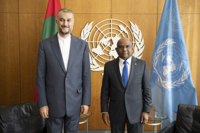 In this photo provided by the United Nations, United Nations General Assembly President Abdulla Shahid of Maldives, right, meets with Iran's Foreign Minister Hossein Amir Abdollahian, during 76th session of the United Nations General Assembly, Thursday, Sept. 23, 2021, at UN headquarters. (United Nations/Evan Schneider via AP)