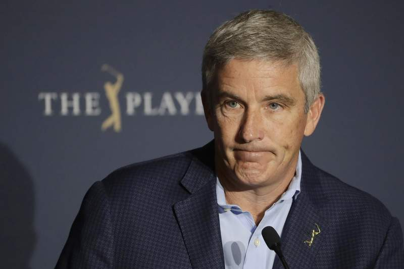 FILE - PGA Tour Commissioner Jay Monahan reacts to a question during a news conference at The Players Championship golf tournament in Ponte Vedra Beach, Fla., in this Friday, March 13, 2020, file photo. Monahan says tournaments next year are prepared to break even without the return of fans.  (AP Photo/Chris O'Meara, File)