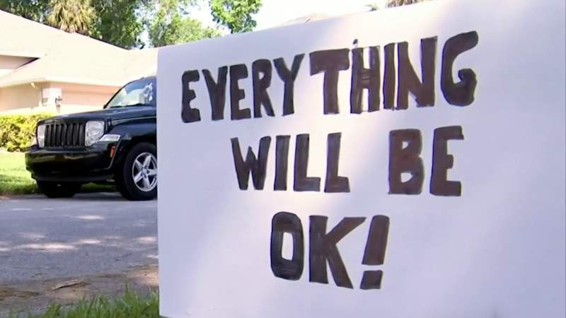 Neighborhood spreads message of hope with sidewalk art, signs amid pandemic