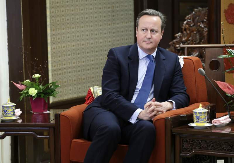 FILE - In this Tuesday, Nov. 27, 2018 file photo, former British Prime Minister David Cameron meets China's Premier Li Keqiang at Zhongnanhai leadership compound, in Beijing, China. Cameron says he never suspected that a financial services company that he lobbied for would go under, threatening thousands of jobs at a steel firm it helped finance. Cameron was summoned Thursday, May 13, 2021 to answer lawmakers questions about his efforts to win government funds for Greensill Capital, which collapsed in March(Jason Lee/Pool Photo via AP, file)
