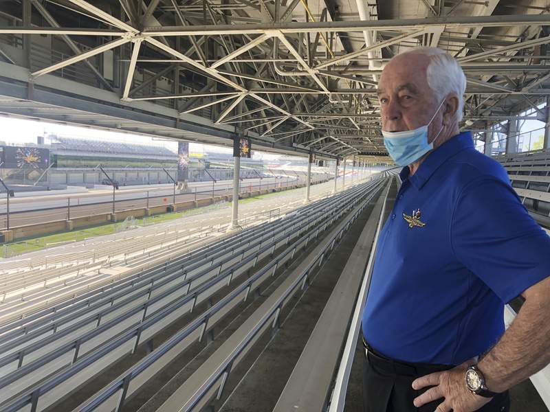 FILE - Roger Penske looks over the track from the grandstand at Indianapolis Motor Speedway in Indianapolis, in this Thursday, July 2, 2020, file photo. There will be fans at this year's Indianapolis 500, Penske said Monday, March 22, 2021, but how many remains a moving target based on pandemic restrictions. Penske said more than 170,000 tickets have already been sold for the May 30 race. His first Indy 500 as owner of the historic property ran in front of empty grandstands last year.  (AP Photo/Jenna Fryer, File)