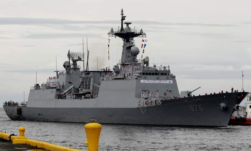 FILE - In this Sept. 2, 2019, file photo, South Korean navy destroyer, the Munmu The Great, prepares to dock at the Manila South Harbor for a three-day port call off Manila, Philippines. South Korea said Sunday, July 18, 2021, it'll send military transport aircraft to bring back hundreds of sailors aboard the destroyer on an anti-piracy mission after nearly 70 of them tested positive for coronavirus. (AP Photo/Bullit Marquez, File)