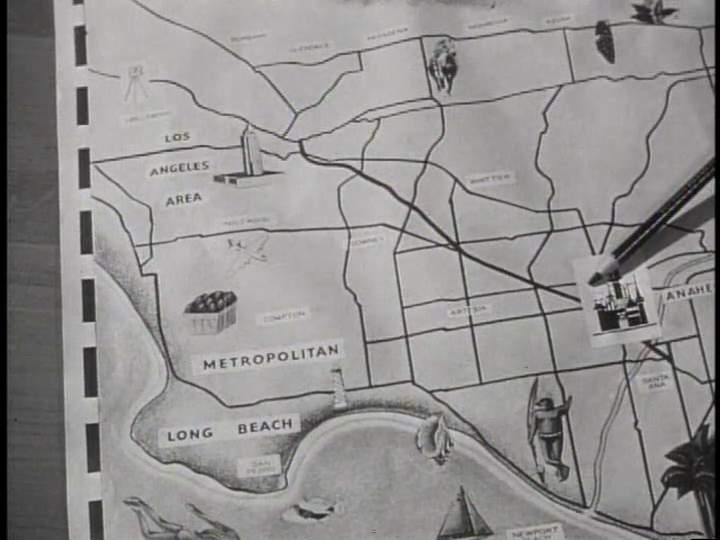 Walt Disney points to a map of Anaheim, CA as seen on the Disneyland TV series in October, 1954