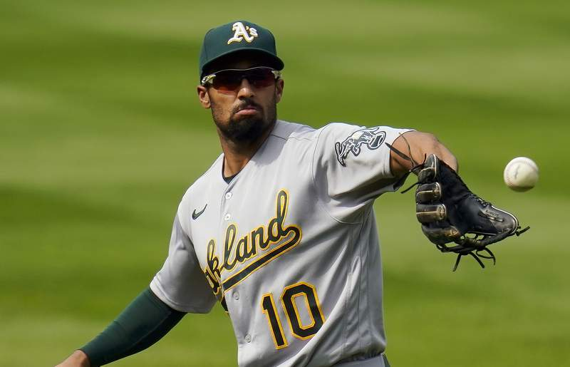 FILE - In this Wednesday, Sept. 16, 2020 file photo, Oakland Athletics shortstop Marcus Semien (10) catches a ball during the fourth inning of a baseball game against the Colorado Rockies in Denver. Shortstop Marcus Semien agreed to an $18 million, one-year contract with the Toronto Blue Jays, a person familiar with the negotiations told The Associated Press.(AP Photo/Jack Dempsey, File)
