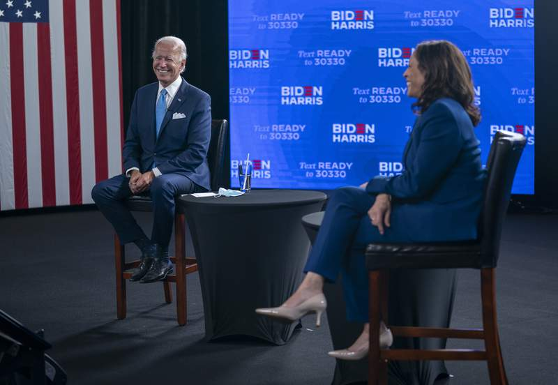 FILE - In this Aug. 12, 2020, file photo Democratic presidential candidate former Vice President Joe Biden and his running mate Sen. Kamala Harris, D-Calif., participate in a virtual grassroots fundraiser at the Hotel DuPont in Wilmington, Del. The Democratic Party will convene Monday, Aug. 17, sort of, amid a pandemic that has upended the usual pomp-and-circumstance of presidential nominating conventions. (AP Photo/Carolyn Kaster, File)