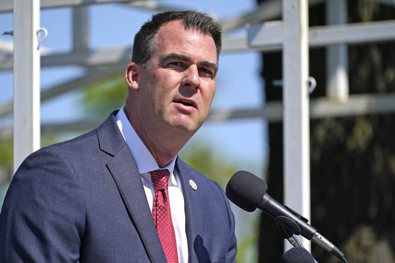 FILE - In this May 7, 2021, file photo, Oklahoma Gov. Kevin Stitt speaks during an Oklahoma Law Enforcement Memorial Ceremony in Oklahoma City. Oklahoma is making voting slightly easier, a contrast to other Republican-led states. Republican Gov. Stitt recently signed a bill that adds a day of early voting and makes changes to ensure mail-in ballots are received in time to be counted. (AP Photo/Sue Ogrocki File)