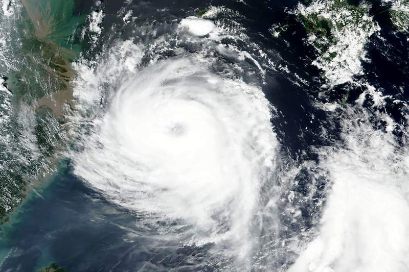 This Aug. 25, 2020, satellite image released by NASA shows Typhoon Bavi near South Korean island of Jeju. Typhoon Bavi as of Wednesday morning was near the South Korean island of Jeju and was on course to hit the northwest coast of the Korean Peninsula around daybreak Thursday morning. South Korea's weather agency said it had a maximum wind speed of 155 kilometers per hour (96 mph) and was forecast as one of the strongest to hit the peninsula this year. (NASA Worldview, Earth Observing System Data and Information System (EOSDIS) via AP)