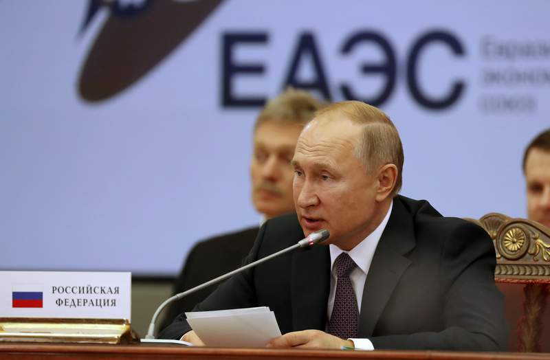 Russian President Vladimir Putin speaks during a meeting of the Supreme Eurasian Economic Council in St.Petersburg, Russia, Friday, Dec. 20, 2019. (Anatoly Maltsev/Pool Photo via AP)