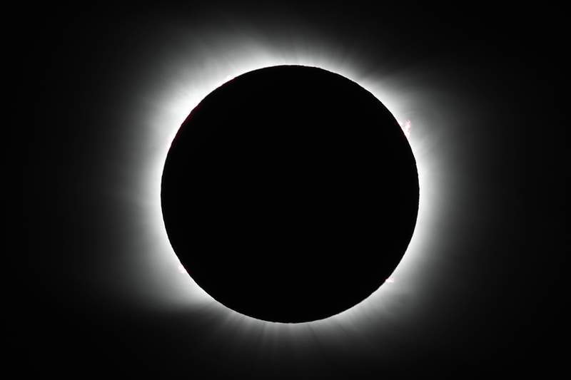 The moon covers the sun during a total solar eclipse in Piedra del Aguila, Argentina, Monday, Dec. 14, 2020. The total solar eclipse was visible from the northern Patagonia region of Argentina and from Araucania in Chile, and as a partial eclipse from the lower two-thirds of South America. (AP Photo/Natacha Pisarenko)