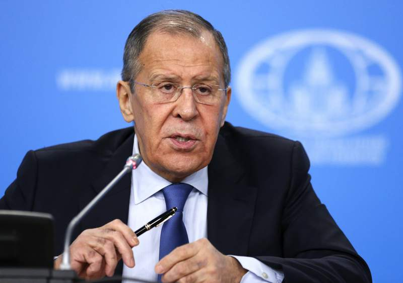 """In this photo taken on Friday, Jan. 17, 2020, Russian Foreign Minister Sergey Lavrov, speaks during a news conference in Moscow, Russia. Russia's foreign minister has angrily rejected Western claims that Moscow is using the coronavirus crisis to expand its political influence. Foreign Minister Sergey Lavrov said Tuesday, April 14 that suggestions from some in the West that Russia had opaque motives for helping Italy respond to the virus resulted from """"Russophobia."""" (AP Photo/Alexander Zemlianichenko)"""