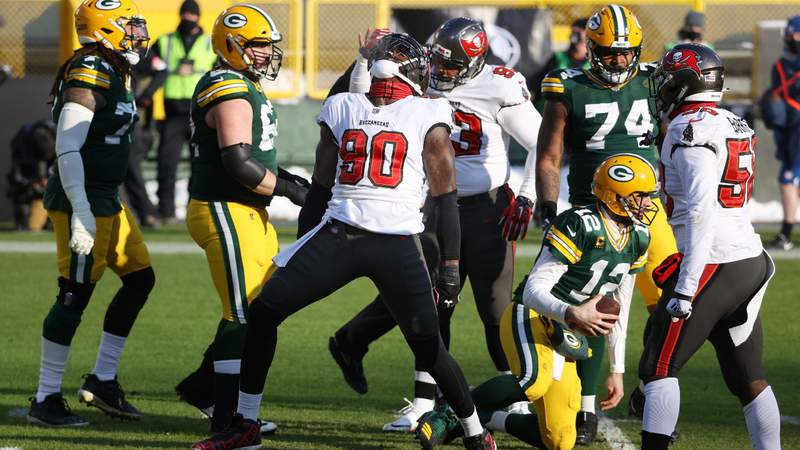 Jason Pierre-Paul #90 of the Tampa Bay Buccaneers celebrates after sacking Aaron Rodgers #12 of the Green Bay Packers in the first quarter during the NFC Championship game. (Photo by Dylan Buell)