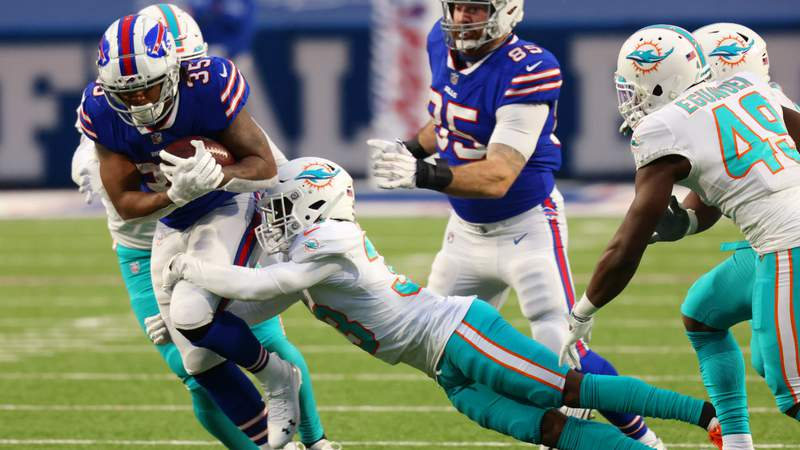 Jomal Wiltz #33 of the Miami Dolphins tackles Antonio Williams #35 of the Buffalo Bills in the fourth quarter at Bills Stadium on January 03, 2021 in Orchard Park, New York. (Photo by Timothy T Ludwig)